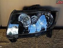 Imagine Faruri cheroke compass 2008 aduc la comanda si piese Piese Auto
