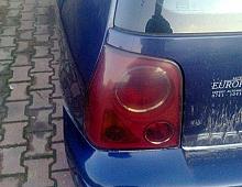 Imagine Lampi spate pe interior rosu si negru Piese Auto