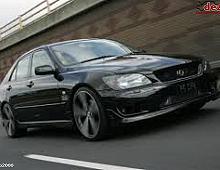 Imagine Dezmembrez Lexus is 200 Motor cutie usi faruri capota etc Piese Auto