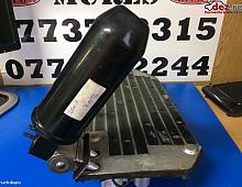 Imagine Radiator clima+butelie freon din cabina Piese Camioane